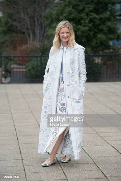Model and Photographer Candice Lake wears a Peter Pilotto coat and dress Jimmy Choo bag and Camilla Elphick shoes on day 3 of London Womens Fashion...