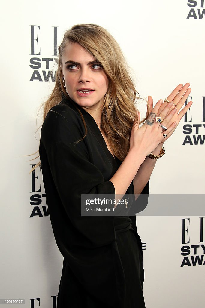 Model and presenter Cara Delevingne poses in the winners room at the Elle Style Awards 2014 at one Embankment on February 18, 2014 in London, England.