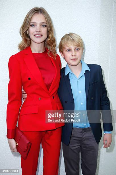 Model and President of the 'Naked Heart Foundation' Natalia Vodianova and her son Lucas Portman attend 'The strange city' Exhibition by Ilya and...