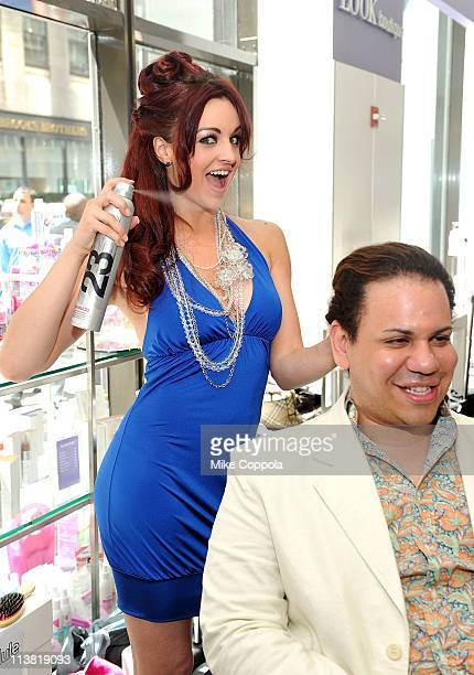 Model and professional wrestler Maria Kanellis styles Luis Santiago's hair at the FashionOnTheGo hair styling services celebration at Duane Reade in...