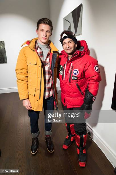 A model and Ray Zahab wait backstage before the Canada Goose x London Celebrating London Flagship Opening and 60th Anniversary event on November 15...