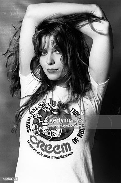 Model and singer Bebe Buell poses for a portrait wearing a Crerem Magazine t-shirt in 1980 in Los Angeles, California.