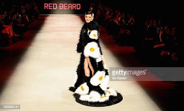 Model and singer Nil Karaibrahimgil walks the runway at the Red Beard by Tanju Babacan show during MercedesBenz Fashion Week Istanbul Fall/Winter...