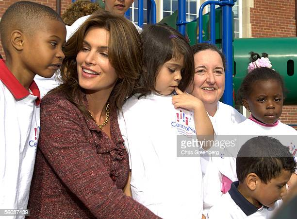 Model and spokeswoman Cindy Crawford poses with a group of children and BB Otero Executive Director of CentroNio in front of a newly constructed...