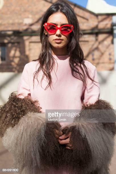 Model and Student Talia Berman wearing a Tuchuzy top Poppy Lissiman sunglasses and Saks Sports coat during MercedesBenz Fashion Week Resort 18...