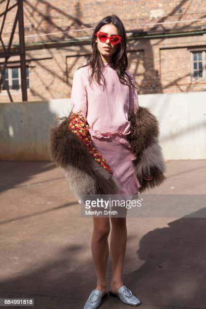 Model and Student Talia Berman wearing a Tuchuzy top Poppy Lissiman sunglasses Saks Sports coat and Dorateymur shoes during MercedesBenz Fashion Week...