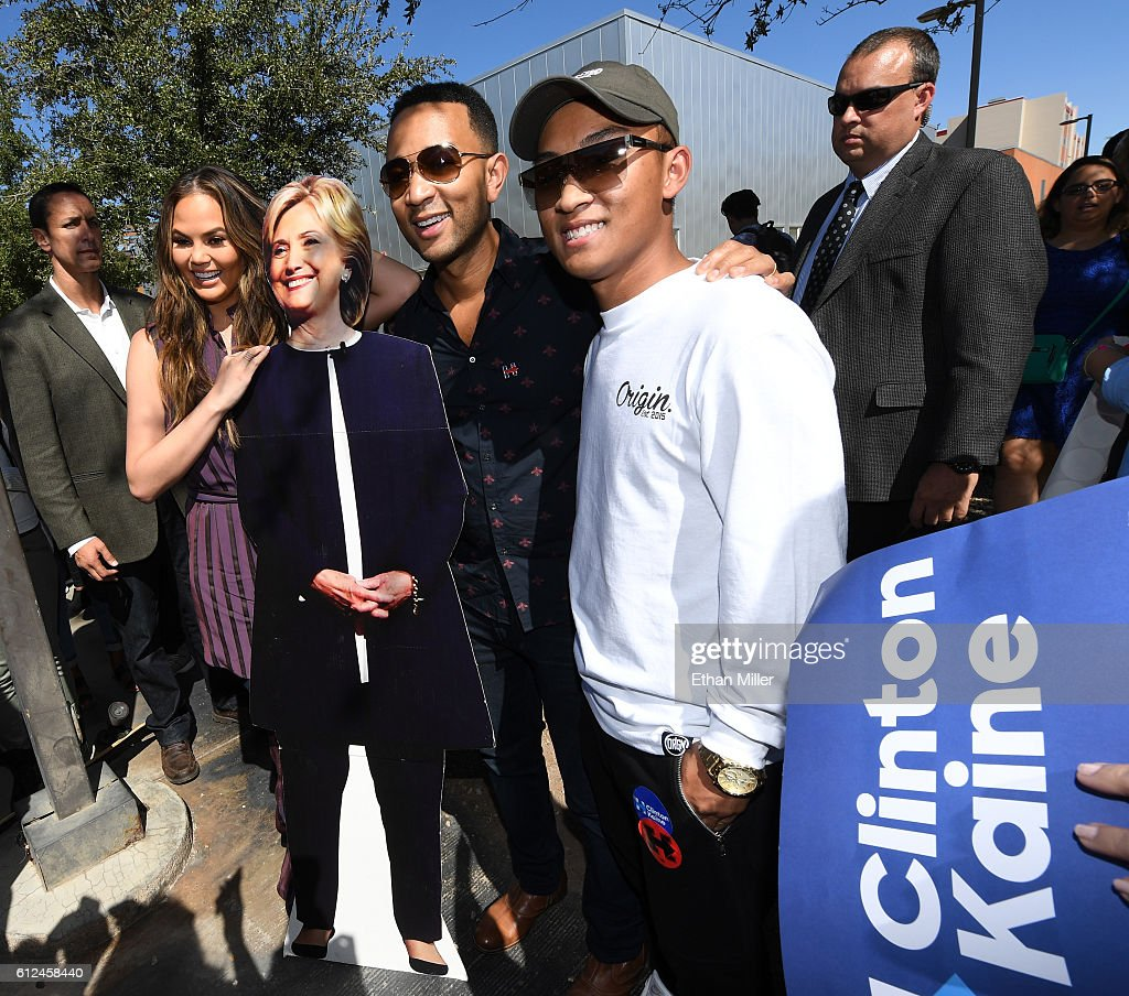 Model and television personality Chrissy Teigen (2nd L) and singer/songwriter John Legend (3rd L) pose with a cardboard cutout of Democratic presidential nominee Hillary Clinton as they take photos with students during a voter registration drive at UNLV on October 4, 2016 in Las Vegas, Nevada.