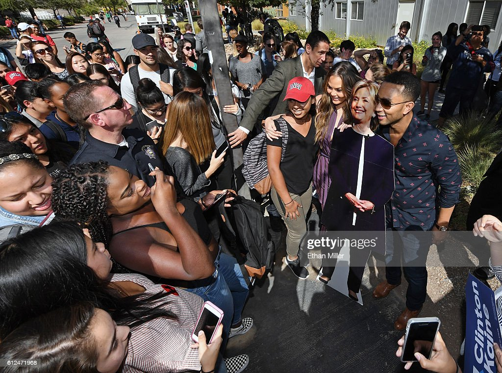 Model and television personality Chrissy Teigen (2nd R) and singer/songwriter John Legend (R) pose with a cardboard cutout of Democratic presidential nominee Hillary Clinton as they take photos with students during a voter registration drive at UNLV on October 4, 2016 in Las Vegas, Nevada.