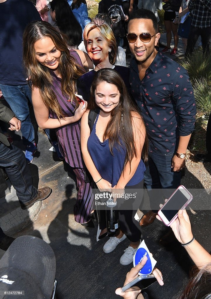Model and television personality Chrissy Teigen (L) and singer/songwriter John Legend (R) pose with a cardboard cutout of Democratic presidential nominee Hillary Clinton as they take photos with students during a voter registration drive at UNLV on October 4, 2016 in Las Vegas, Nevada.