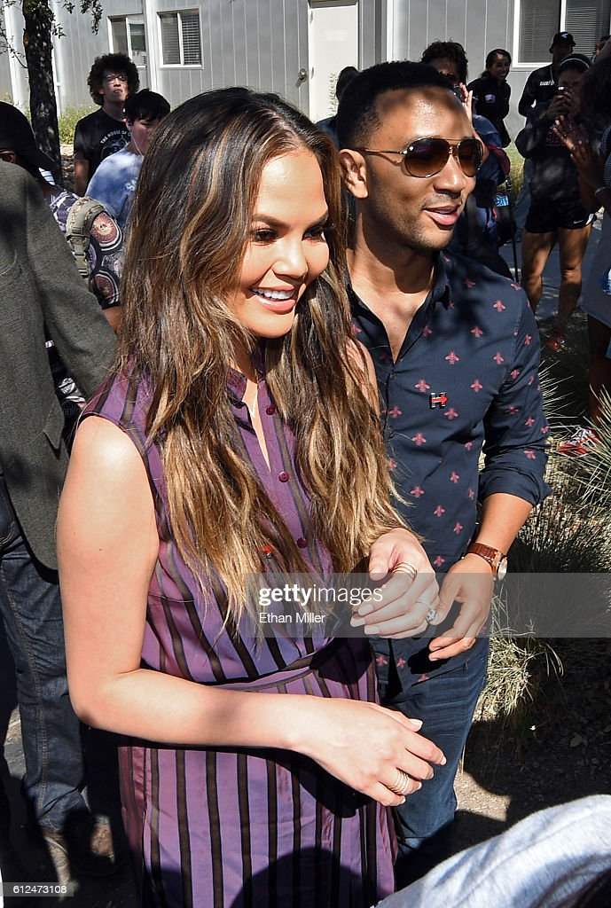 Model and television personality Chrissy Teigen (L) and singer/songwriter John Legend campaign for Democratic presidential nominee Hillary Clinton as they visit with students during a voter registration drive at UNLV on October 4, 2016 in Las Vegas, Nevada.