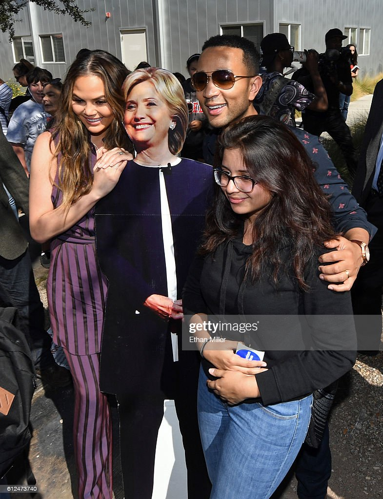 Model and television personality Chrissy Teigen (L) and singer/songwriter John Legend (2nd R) pose with a cardboard cutout of Democratic presidential nominee Hillary Clinton as they take photos with students during a voter registration drive at UNLV on October 4, 2016 in Las Vegas, Nevada.