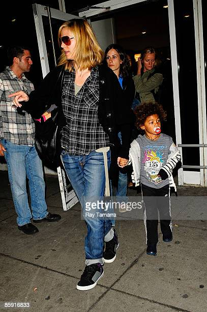 Model and television personality Heidi Klum and her son Henry Günther Ademola Dashtu Samuel leave the John F Kennedy International Airport on April...