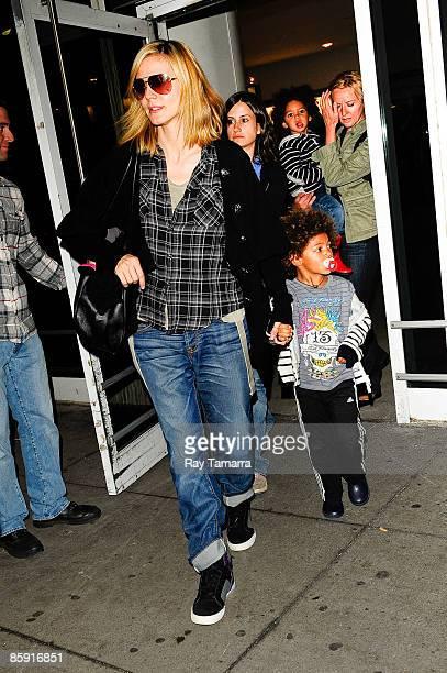 Model and television personality Heidi Klum and her sons Henry Günther Ademola Dashtu Samuel and Johan Riley Fyodor Taiwo Samuel leave the John F...