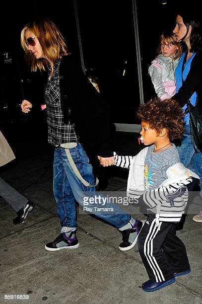Model and television personality Heidi Klum her son Henry Günther Ademola Dashtu Samuel and her daughter Leni Klum leave the John F Kennedy...