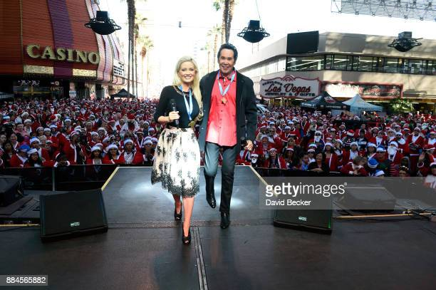 Model and television personality Holly Madison and entertainer Wayne Newton attend the 13th annual Las Vegas Great Santa Run benefiting Opportunity...