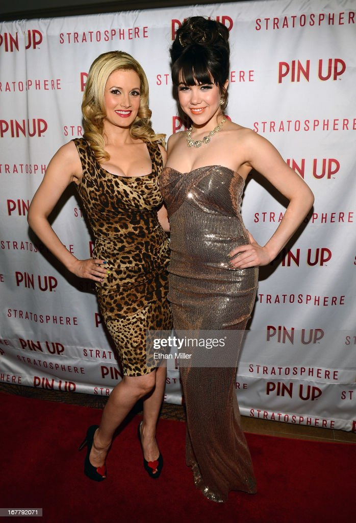 Model and television personality Holly Madison (L) and model Claire Sinclair arrive at the premiere of the show 'Pin Up' at the Stratosphere Casino Hotel on April 29, 2013 in Las Vegas, Nevada.