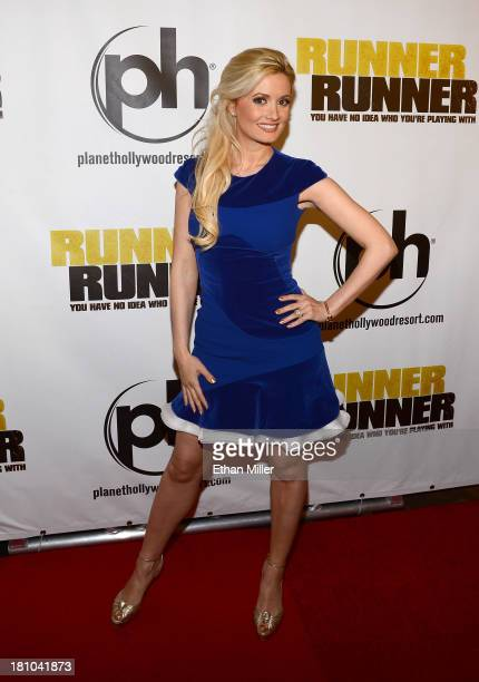 Model and television personality Holly Madison arrives at the world premiere of Twentieth Century Fox and New Regency's film Runner Runner at Planet...