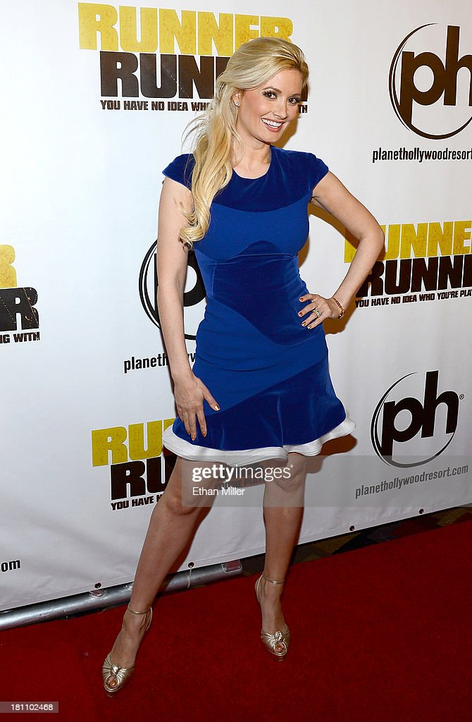 Model and television personality Holly Madison arrives at the world premiere of Twentieth Century Fox and New Regency's film 'Runner Runner' at Planet Hollywood Resort & Casino on September 18, 2013 in Las Vegas, Nevada.