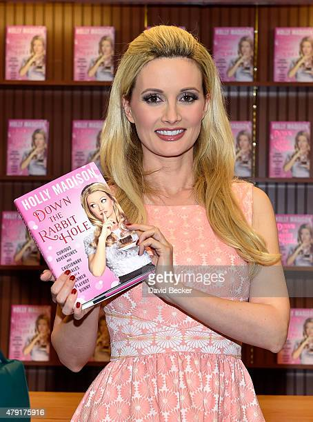 Model and television personality Holly Madison attends a signing for her new book 'Down the Rabbit Hole Curious Adventures and Cautionary Tales of a...