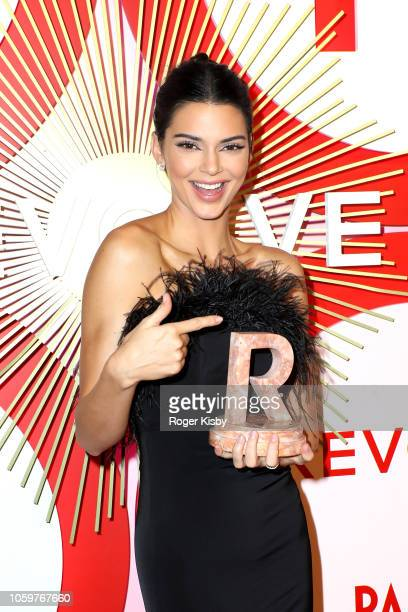 Model and television personality Kendall Jenner holds her award for 'Icon of the Year' during Revolve's second annual #REVOLVEawards at Palms Casino...