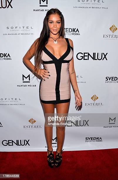Model and television personality Nabilla Benattia arrives at the Genlux Magazine release party with Erika Christensen at Sofitel Hotel on August 29...