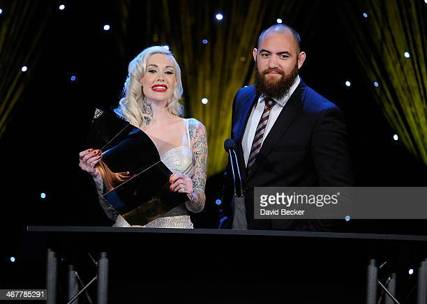 Model and television personality Sabina Kelley and Mixed martial artist Travis Browne present the Shawn Tompkins Coach of the Year award during the...