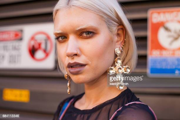 Model and Travel Blogger Tegan Phillipa wearing DIY by Panida dress and Beginning Boutique earrings during MercedesBenz Fashion Week Resort 18...