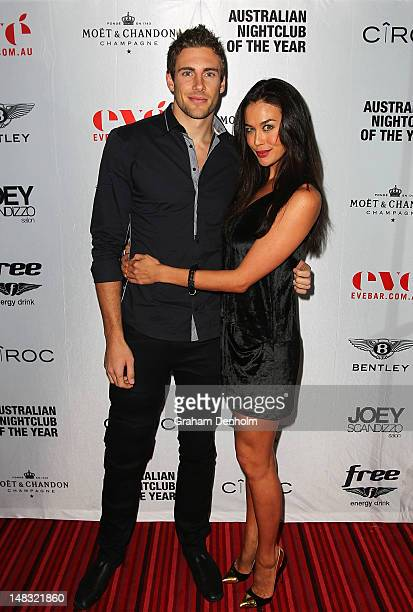 Model and TV personality Megan Gale and partner AFL player Shaun Hampson arrive at the Chris Judd launch party at Eve Bar and Lounge on July 14 2012...