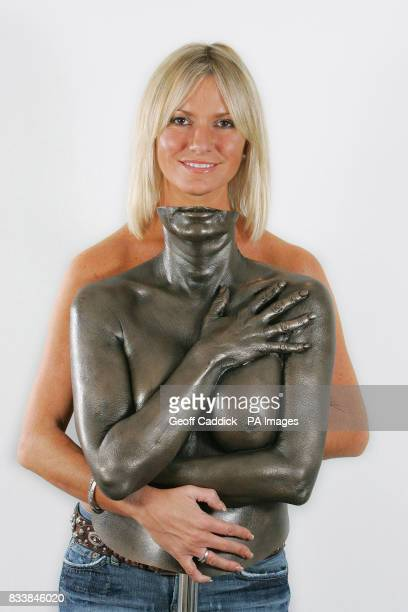 Model and TV presenter Alex Best with a bronze cast of herself made to promote breast self examination