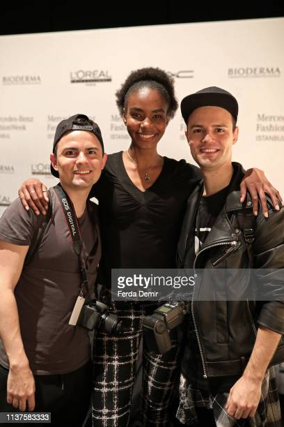 A model and two photographers pose backstage at the MiiN by Kadir Kilic show during MercedesBenz Istanbul Fashion Week at Zorlu Performance Hall on...