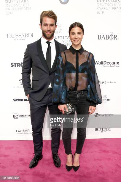 Model Andre Hamann and German actress Aylin Tezel during the Duftstars at Flughafen Tempelhof on April 25 2018 in Berlin Germany