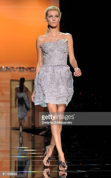 Model Andrea Stancu walks down the runway during the Ermanno Scervino show as part of Milan Womenswear Fashion Week Spring/Summer 2010 on September...