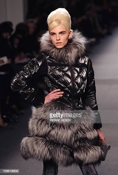 Model Andreja Pejic displays a creation by French designer Jean Paul Gaultier during the Autumn/Winter 20112012 readytowear collection show on March...
