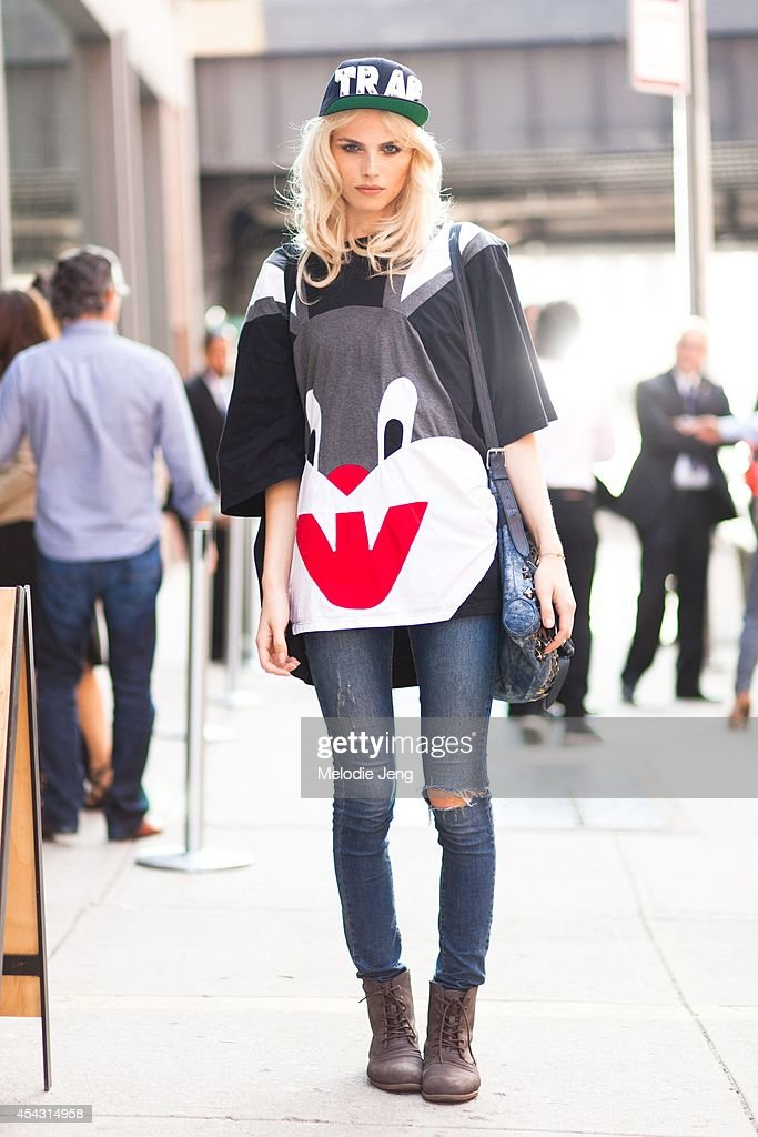 Model Andreja Pejic wears an Adeen cap and Bugs Bunny jersey in August 2012 outside Milk Studios, Meatpacking District, New York City.