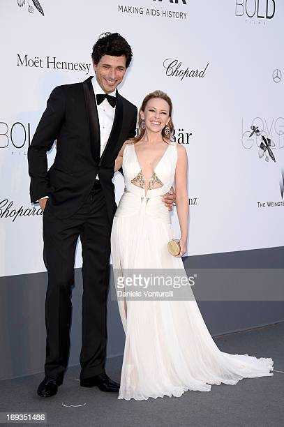Model Andres Velencoso and singer Kylie Minogue attend attends amfAR's 20th Annual Cinema Against AIDS during The 66th Annual Cannes Film Festival at...