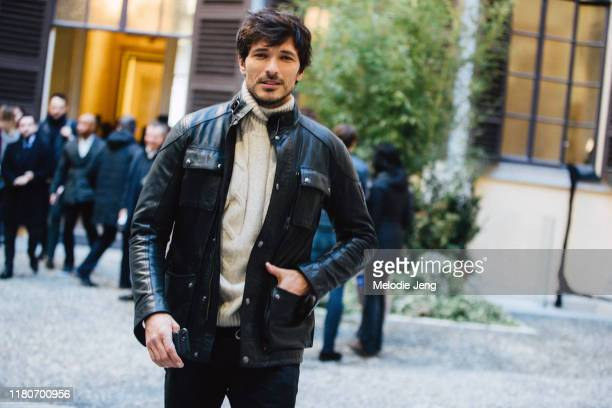 Model Andres Velencoso Segura wears a black leather jacket and white knit sweater after the Pal Zileri show during Milan Menswear Fashion Week...
