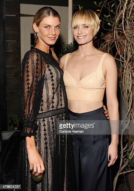 Model Angela Lindvall and actress Amber Valletta attend HM Conscious Exclusive Dinner at Eveleigh on March 19 2014 in West Hollywood California