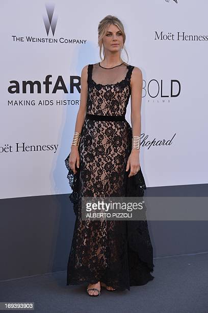 US model Angela Lindvall poses on May 23 2013 as she arrives for the amfAR's 20th Annual Cinema Against AIDS during the 66th Annual Cannes Film...
