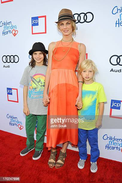 Model Angela Lindvall with sons Sebastian Edwards and William Edwards arrive at the 1st Annual Children Mending Hearts Style Sunday on June 9 2013 in...