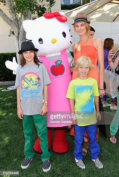 Model Angela Lindvall with sons Sebastian Edwards and William Edwards attend the 1st Annual Children Mending Hearts Style Sunday on June 9 2013 in...