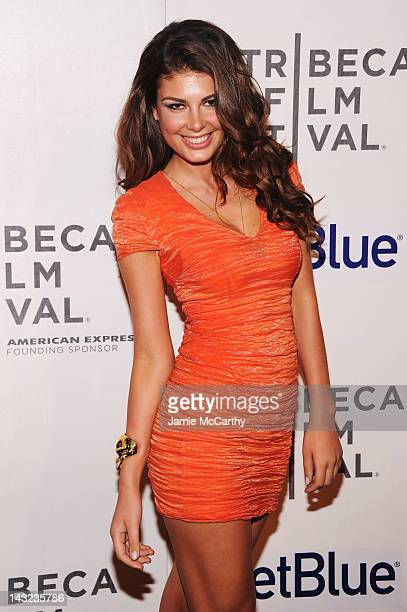 Model Angela Martini walks the red carpet at the World Premiere Of Morgan Spurlock's 'MANSOME' at the Tribeca Film Festival on April 21 2012 in New...
