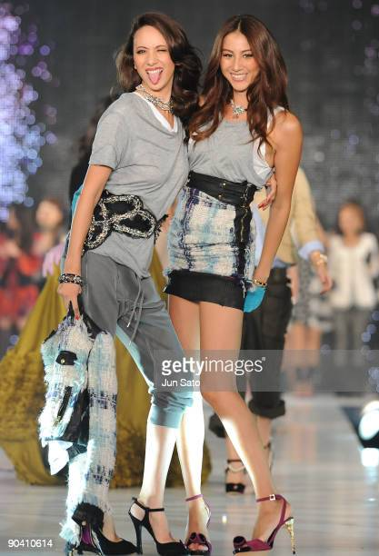 Model Angelica Michibata and Karen Michibata walk the runway at Kobe Collection 2009 Autumn/Winter at Grand Prince Hotel on September 6 2009 in Tokyo...