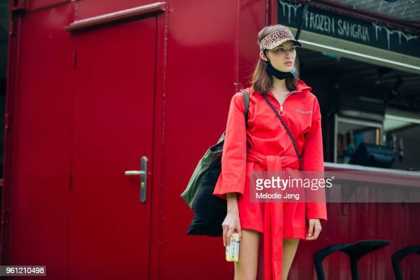 Model Ania Chiz wears a leopard visor and bold red dress during London Fashion Week Spring/Summer 2018 on September 17 2017 in London England