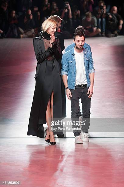 Model Anja Rubik and Designer Anthony Vaccarello walk the runway during the Anthony Vaccarello show as part of the Paris Fashion Week Womenswear...