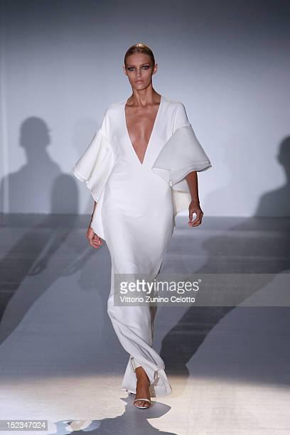Model Anja Rubik walks the runway at the Gucci Spring/Summer 2013 fashion show as part of Milan Womenswear Fashion Week on September 19 2012 in Milan...
