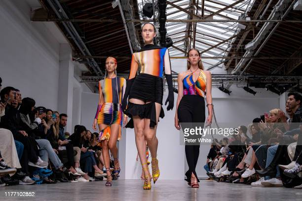 Model, Anna Cleveland and a model walks the runway during the Mugler Womenswear Spring/Summer 2020 show as part of Paris Fashion Week on September...