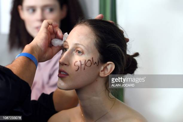 US model Anna Cleveland has her make up done backstage prior to the JeanPaul Gaultier 2019 SpringSummer Haute Couture collection fashion show in...