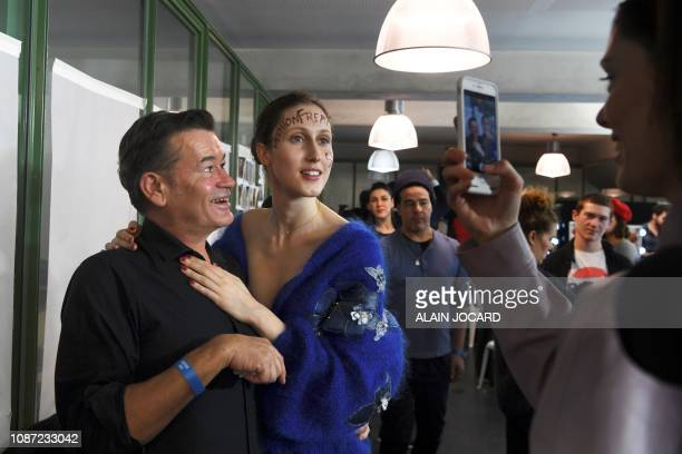 US model Anna Cleveland poses for a picture backstage with French make up artist Stephane Marais prior to the JeanPaul Gaultier 2019 SpringSummer...