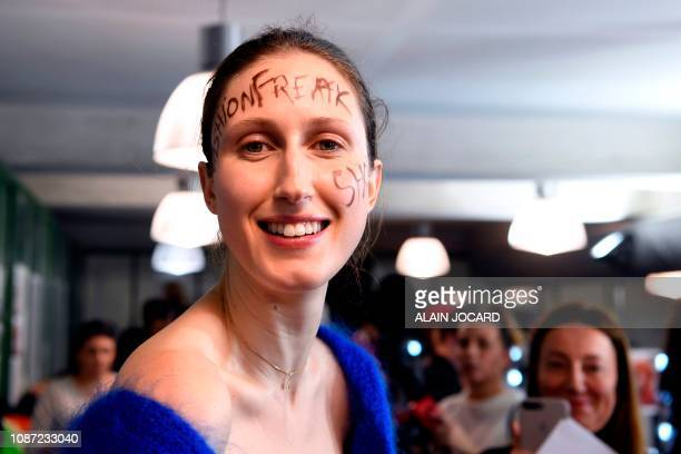 US model Anna Cleveland prepares backstage prior to the JeanPaul Gaultier 2019 SpringSummer Haute Couture collection fashion show in Paris on January...