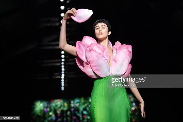 TOPSHOT Model Anna Cleveland presents a creation for fashion house Moschino during the Women's Spring/Summer 2018 fashion shows in Milan on September...
